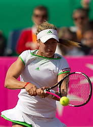 Eugenie Bouchard of Canada returns the ball to  Polona Hercog of Slovenia   during the first day of the tennis Fed Cup match between Slovenia and Canada at Bonifika, on April 16, 2011 in Koper, Slovenia.  (Photo by Vid Ponikvar / Sportida)