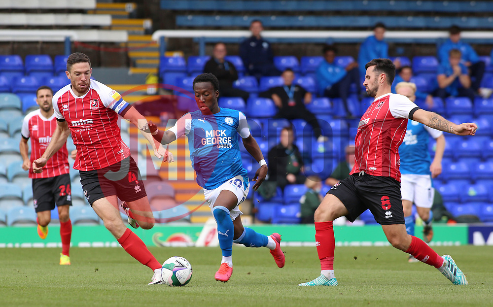 Siriki Dembele of Peterborough United skips past Ben Tozer and Chris Clements of Cheltenham Town - Mandatory by-line: Joe Dent/JMP - 05/09/2020 - FOOTBALL - Weston Homes Stadium - Peterborough, England - Peterborough United v Cheltenham Town - Carabao Cup