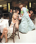 Girl smoking at a party at the Titanic restaurant. London. 2001. Archive panoramas 2001