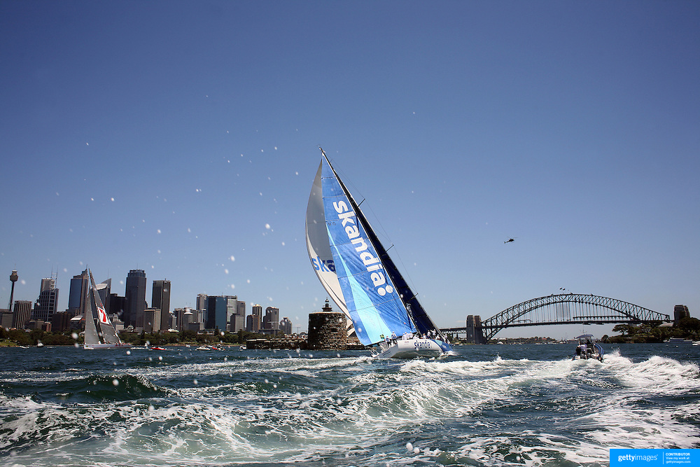 Wild Oats XI (left) heads for victory in the Solas Big Boat Challenge, followed by Skandia (right) on Sydney Harbour on December 16, 2008 in Sydney, Australia. The race conducted in the waters around Sydney Harbour, is a preliminary tournament to the Rolex Sydney Hobart Yacht race 2008 which will start of Boxing Day, December 26th.. Wild Oats XI achieved a hat trick of line honours wins when it won the Sydney to Hobart race last year equaling Morna's record achieved in the 1946-1948 races. Wild Oats XI will return to attempt a fourth successive line honours win in this years race. Photo Tim Clayton