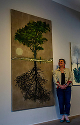 Pictured: Kate Downie<br /><br />Inspired by the cyclical nature of the seasons, ten tree paintings form the heart of this exhibition and uniquely can be viewed through 180 degrees form the heart of this exhibition. Each image forms a mirror-like reflection, capturing the continual state of transition in nature.  <br /><br />The jacket kate is wearing is made of the same material that her paintings that painted on, produced by a Fife company<br /><br />Ger Harley | EEm 3 June 2021