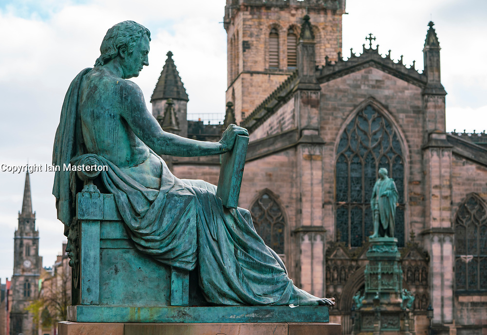 Statue of David Hume and St Giles Cathedral on the Royal Mile in Edinburgh Old Town, Scotland, UK