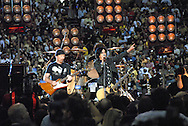 Photograph of U2 & Green Day performing at the pregame show at the reopening of the Superdome, Sept. 26, 2006 in New Orleans, LA.