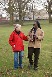 Couple walking in park laughing. Cleared for Mental Health issues.