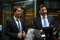Sir Cliff Richard (left) with his lawyer Gideon Benaim said outside the Rolls Building in London where he was awarded more than £200,000 in damages after winning his High Court privacy battle against the BBC over its coverage of a police search of his home in Sunningdale, Berkshire, in August 2014, following a child sex assault allegation.