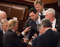 United States President Donald J. Trump chats with US Representative Jason Chaffetz (R-UT) after addressing a joint session of Congress on Capitol Hill in Washington, DC, USA, February 28, 2017. Photo by Chris Kleponis/CNP/ABACAPRESS.COM
