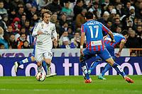Real Madrid´s Luka Modric and Levante UD´s Jordi Xumetra Feliu during 2014-15 La Liga match between Real Madrid and Levante UD at Santiago Bernabeu stadium in Madrid, Spain. March 15, 2015. (ALTERPHOTOS/Luis Fernandez)