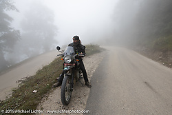 Gary Thomas checks out the mountainside fog in Motorcycle Sherpa's Ride to the Heavens motorcycle adventure in the Himalayas of Nepal. Riding from Chitwan to Daman. Tuesday, November 12, 2019. Photography ©2019 Michael Lichter.