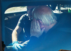 © Licensed to London News Pictures. 30/08/2016. Bognor Regis, UK. An paramedic assists a man (R) who it is believed was held up in a house during an armed siege in Pagham. A 72 year old man  has been in a stand-off with police since 4pm on Sunday.  Photo credit: Peter Macdiarmid/LNP