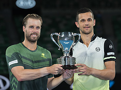 MELBOURNE, Jan. 27, 2018  Austria's Oliver Marach (L) and Croatia's Mate Pavic pose with trophy after winning the men's doubles final against Colombia's Juan Sebastian Cabal and Robert Farah at the Australian Open in Melbourne, Australia, Jan. 27, 2018. (Credit Image: © Zhu Hongye/Xinhua via ZUMA Wire)