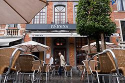 Pedestrians walk past the trendy Rodins restaurant and bar, on the Oude Markt, in Leuven, Belgium, Saturday, Sept. 13, 2008.  (Photo © Jock Fistick)