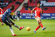Southend United defender Elvis Bwomono (2) takes a shot which is blocked by Charlton Athletic midfielder Tariqe Fosu (11) during the EFL Sky Bet League 1 match between Charlton Athletic and Southend United at The Valley, London, England on 9 February 2019.