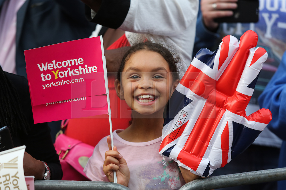 © Licensed to London News Pictures. 28/09/2016. Leeds, UK. A girl in the crowd waves her banner at the Olympic and Paralympic parade in Leeds. Yorkshire's Olympic and Paralympic stars receive a heroes' welcome during an open top bus parade in Leeds, West Yorkshire. . Photo credit : Ian Hinchliffe/LNP