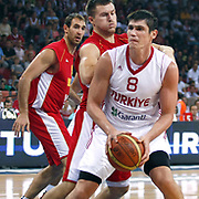 Turkey's Ersan ILSAYOVA (R) during their Istanbul CUP 2011match played Montenegro between Turkey at Abdi Ipekci Arena in Istanbul, Turkey on 25 August 2011. Photo by TURKPIX