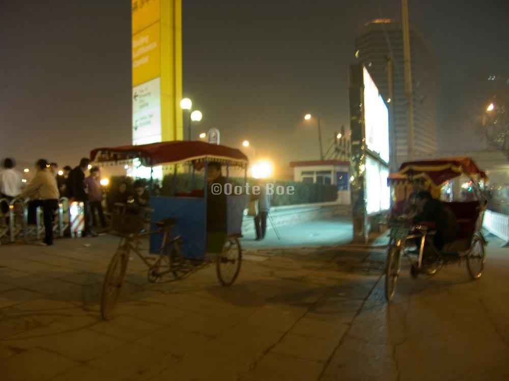 tricycle bike riders waiting for passengers Beijing China