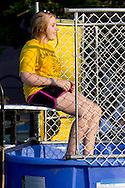 Middletown, New York - A girl takes a turn in the dunking booth during the Camp Funshine Carnival Night on Aug. 16, 2012. When people hit a target with a ball, she fell into the water.