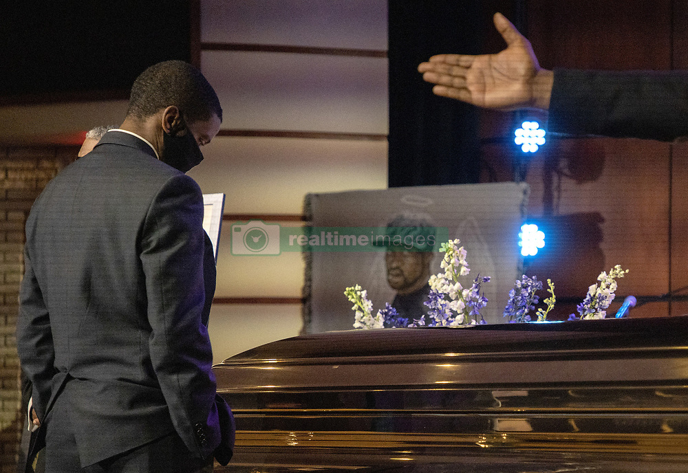 St. Paul, Minn., mayor Melvin Carter stands at the casket before a memorial service for George Floyd at North Central University in Minneapolis on Wenesday, June 4, 2020. Photo by Carlos Gonzalez/Minneapolis Star Tribune/TNS/ABACAPRESS.COM