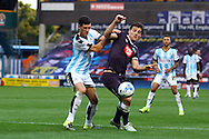 Mark Hudson of Huddersfield town and Chris Martin of Derby County battle for the ball. Skybet football league Championship match, Huddersfield Town v Derby county at the John Smith's Stadium in Huddersfield , Yorkshire on Saturday 24th October 2015.<br /> pic by Chris Stading, Andrew Orchard sports photography.
