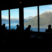 A view of Queenstown from Skyline Queenstown restaurant and cafe. Skyline is accessible by scenic gondola and has panoramic views of Queenstown, The Remarkables mountain range and Lake Wakatipu...Queenstown is nestled on the shores of the crystal clear waters of Lake Wakatipu in the Central Otago region of the South Island of New Zealand..Queenstown is New Zealand's premier tourist destination providing an abundance of year round outdoor activities for both young and old. Queenstown, Central Otago, South Island, New Zealand. 18th May 2011. Photo Tim Clayton..