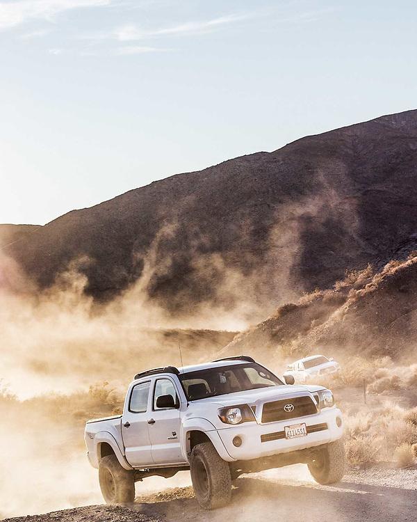 California automotive photographer Raymond Rudolph photographs a Toyota Tacoma off-roading through the Mojave Desert