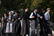 Historical and fictional theatre play acted out on the streets of the town, and with young actors wearing traditional costumes and performing traditional dance for European heritage days on 18th September 2021 in Pont Croix, Brittany, France. Brittany is a peninsula, historical county, and cultural area in the west of France, covering the western part of what was known as Armorica during the period of Roman occupation. It became an independent kingdom and then a duchy before being united with the Kingdom of France in 1532 as a province governed as a separate nation under the crown.