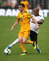 Woverhampton Wanderers Diogo Jota (left) is challenged Derby County's Andre Wisdom during the pre-season friendly match at Pride Park, Derby.