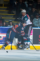 KELOWNA, CANADA - MARCH 24: Deven Sideroff #34 of the Kamloops Blazers checks Devante Stephens #21 of the Kelowna Rockets at the board during first period on March 24, 2017 at Prospera Place in Kelowna, British Columbia, Canada.  (Photo by Marissa Baecker/Shoot the Breeze)  *** Local Caption ***