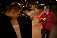 As night begins, some volunteers get ready to go to the bus station to see if any migrant in transit arrives so he can be driven to the Red Cross device. Irun (Basque Country). December 19, 2018. A group of volunteers has created a host network to serve migrants and inform about the public services they are entitled to and the ways to cross the border. This group of volunteers is avoiding a serious humanitarian problem Irun, the Basque municipality on the border with Hendaye. As the number of migrants arriving on the coasts of southern Spain incresead, more and more migrants are heading north to the border city of Irun. French authorities have reacted by conducting random checks as far as the city of Bordeaux, more than 200 kilometers north of the border. Migrants who are caught are then deported back to Irun. (Gari Garaialde / Bostok Photo).