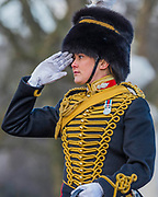 On the 100th anniversary of women getting the vote, Kings troop is led by female officers (here the Troop Captain salutes Buckingham Palace) and has a high proportion of female troopers - The King's Troop Royal Horse Artillery, ride their horses and gun carriages past Buckingham Palace to Green Park to stage a 41 Gun Royal Salute to mark the 66th Anniversary of the Accession of Her Majesty The Queen.