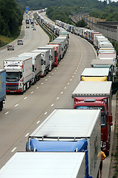 © Licensed to London News Pictures. 28/07/2015<br /> Now two queues one for ferries one for euro trains.<br /> <br /> Operation stack lorries between J8 and J9 for Ashford on the M20. <br /> Operation stack is back on the M20 in Kent.<br /> Just days after Operation Stack was taken off the M20, it was brought back in the early hours of this morning.<br /> The authorities are blaming a heavy volume of traffic heading towards the Port of Dover and Eurotunnel and the continued disruption in Calais.<br /> The coast-bound carriageway between junctions 8 and 9 is closed to allow lorries to park, but the slip roads at junctions 9, 10 and 12 and 13 have also been shut. <br /> <br /> (Byline:Grant Falvey/LNP)