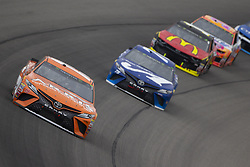 June 10, 2018 - Brooklyn, Michigan, United States of America - Daniel Suarez (19) races off turn one during the FireKeepers Casino 400 at Michigan International Speedway in Brooklyn, Michigan. (Credit Image: © Stephen A. Arce/ASP via ZUMA Wire)