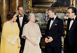 US President Jimmy Carter (second r) speaks with Her Majesties The Queen and the Queen Mother as Prince Philip and Italian Prime Minister Giulio Andreotti (r) look on in the Blue Drawing Room at Buckingham Palace