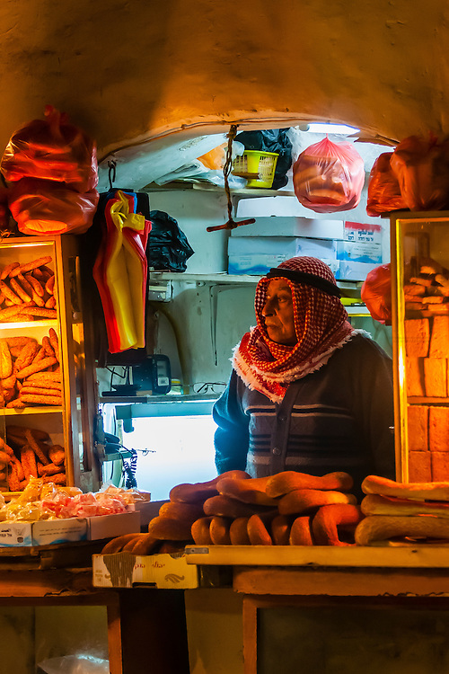 An Arab bread seller named  Salah at his stall in the souk, in the Muslim quarter of the old city, Jerusalem, Israel.