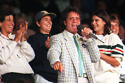 File photo dated 3/7/1996 of tennis players (L-R) Gigi Fernandez and Conchita Martinez cheering as Sir Cliff Richard, who has won his legal action against the BBC over coverage of a police raid at his apartment in Berkshire in August 2014, entertains the Centre Court crowd at Wimbledon this afternoon.