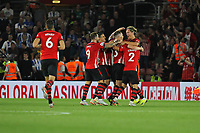 Football - 2018 / 2019 Premier League - Southampton vs. Brighton and Hove Albion<br /> <br /> The Southampton players celebrate with goal scorer Southampton's Pierre-Emile Hojbjerg after his long range effort puts Saints one up in the south coast derby at St Mary's Stadium Southampton<br /> <br /> COLORSPORT/SHAUN BOGGUST
