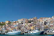 Fishing trawlers in Sciacca Port with the town behind,  south coast of Sicily, Italy