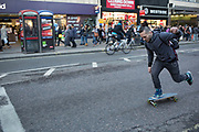 Skateboarder on Oxford Street in central London. This is the busiest shopping district in the capital with Oxford Street being the most crowded. Crowds can be so big that many people avoid the area altogether. There are 548 shops in Oxford Street; it is Europe's busiest shopping area.
