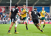 Australia flanker Angus Scott-Young collects the ball under pressure from New Zealand flanker Mitchell Jacobson during the World Rugby U20 Championship 5rd Place play-off  match Australia U20 -V- New Zealand U20 at The AJ Bell Stadium, Salford, Greater Manchester, England on Saturday, June  25  2016.(Steve Flynn/Image of Sport)