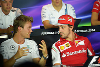 (L to R): Nico Rosberg (GER) Mercedes AMG F1 and Fernando Alonso (ESP) Ferrari in the FIA Press Conference.<br /> Italian Grand Prix, Thursday 4th September 2014. Monza Italy.