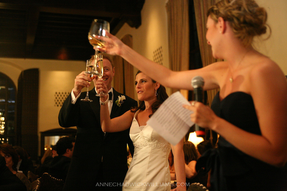 A bride and groom toast at the Sutter Club in Sacramento, California.