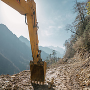 An excavator. From the end of the dirt road, it takes 7 hours to trek up to Laya village.