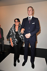 MERA RUBELL with a statue of Prince William at a private view of 'Engagement' an exhibition of new works by Jennifer Rubell held at the Stephen Friedman Gallery, 25-28 Old Burlington Street, London on 7th February 2011.