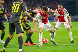 10-04-2019 NED: Champions League AFC Ajax - Juventus,  Amsterdam<br /> Round of 8, 1st leg / Ajax plays the first match 1-1 against Juventus during the UEFA Champions League first leg quarter-final football match / Dusan Tadic #10 of Ajax, Hakim Ziyech #22 of Ajax