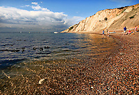 Family relaxing on the beach at alum bay, isle of wight