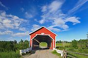 Red covered bridge over the Black River<br /> Ste. Jeanne d'Arc<br /> Quebec<br /> Canada
