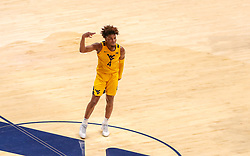 Jan 25, 2021; Morgantown, West Virginia, USA; West Virginia Mountaineers guard Miles McBride (4) celebrates a made three pointer during the second half against the Texas Tech Red Raiders at WVU Coliseum. Mandatory Credit: Ben Queen-USA TODAY Sports