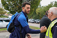 AFC Wimbledon defender Will Nightingale (5) shaking hands with security guardduring the EFL Sky Bet League 1 match between AFC Wimbledon and Rochdale at the Cherry Red Records Stadium, Kingston, England on 5 October 2019.
