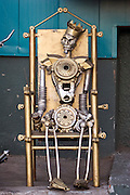 Moscow, Russia, 06/10/2005..Statues made from car spare parts outside an auto repair shop.
