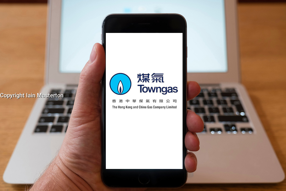 Using iPhone smartphone to display logo of Towngas, Hong Kong utility company