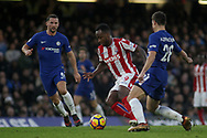 Saido Berahino of Stoke city attempts to find his way through the Chelsea defence .<br /> Premier league match, Chelsea v Stoke city at Stamford Bridge in London on Saturday 30th December 2017.<br /> pic by Kieran Clarke, Andrew Orchard sports photography.